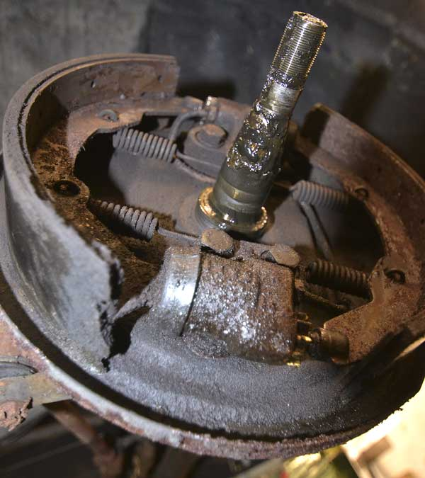 The cylinders were leaking and had contaminated the brake shoes and caused them to begin to delaminate