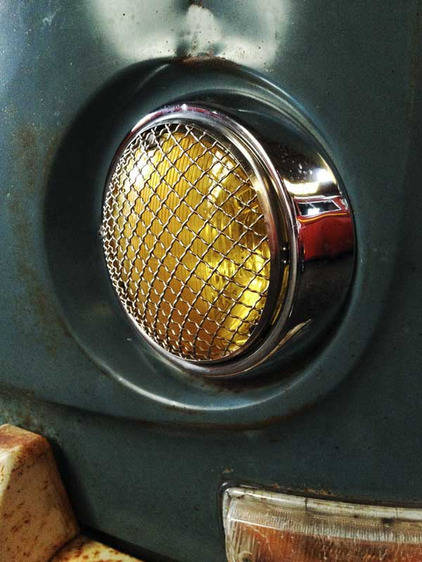 vintage style mesh grilles and yellow headlight lenses looking great on a VW Early Bay Window