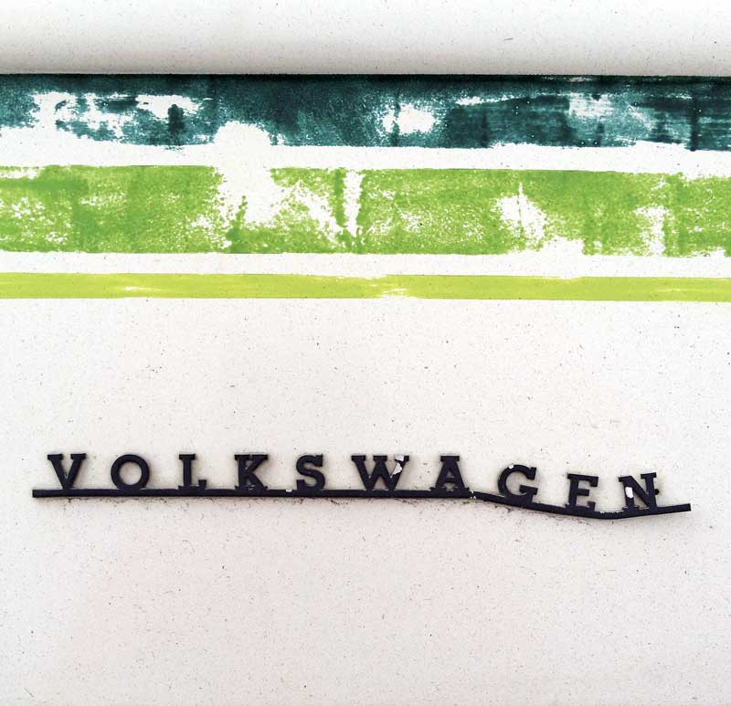 distressed Volkswagen badge script